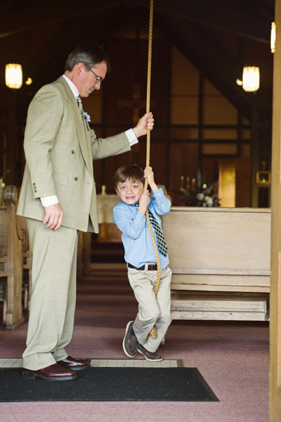 kid ringing church bells