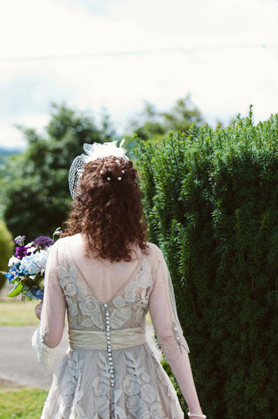 back of BHLDN tea length lace flower wedding dres