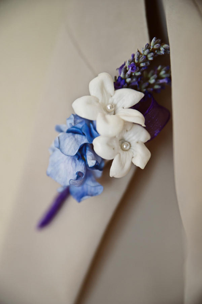 white and blue flower boutonniere