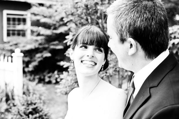 bride smiling up at her groom