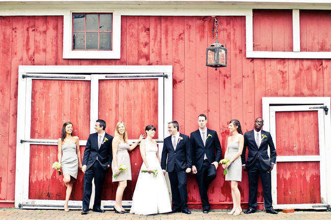 bridal party portrait in front of barn