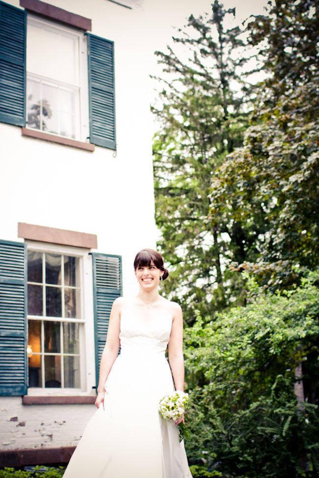 bride smiling on estate grounds