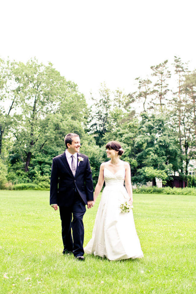 bride and groom walking on estate grounds