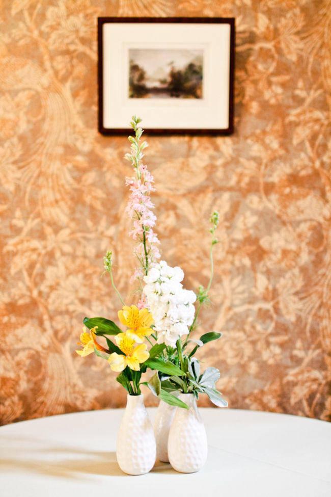 flowers in white vases