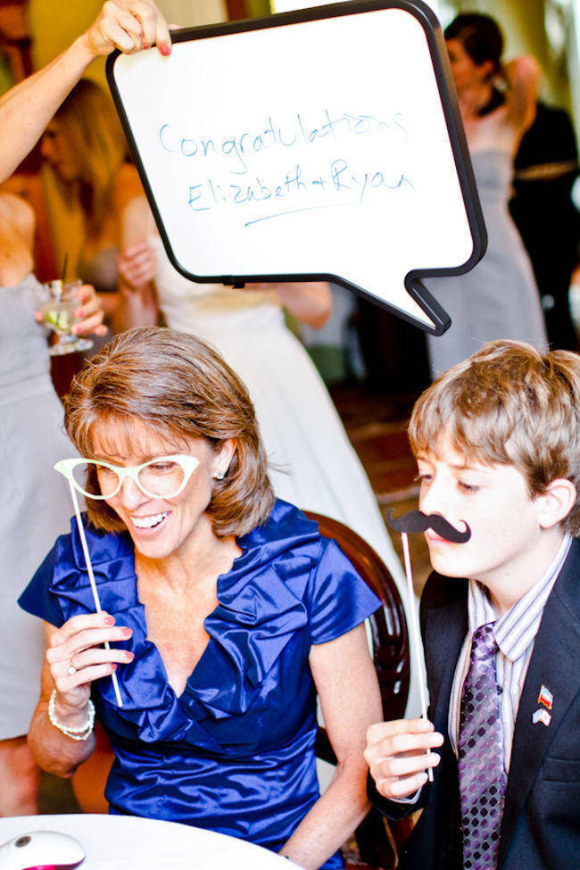 wedding guests with photo booth props