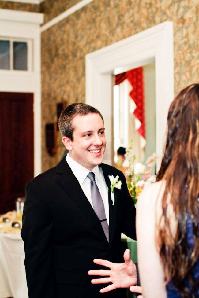 groom talking to wedding guest