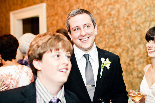 groom smiling at reception