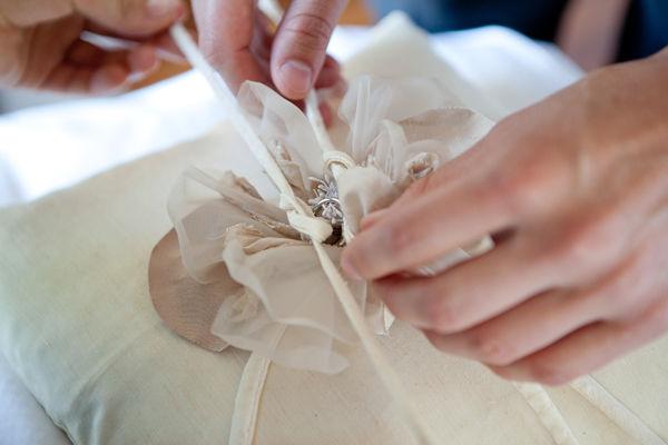 tying rings onto ring pillow