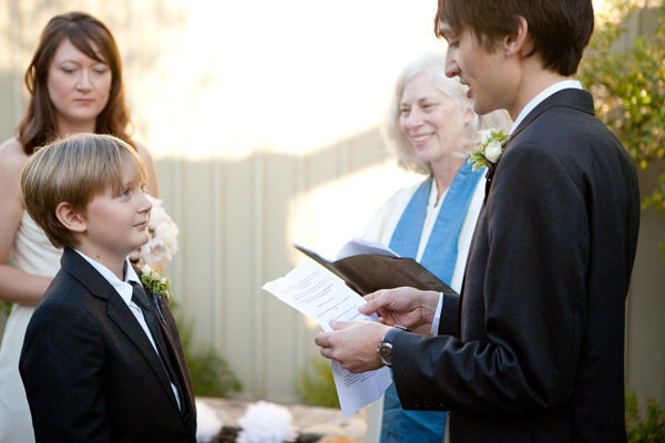 groom reading vows to bride's son