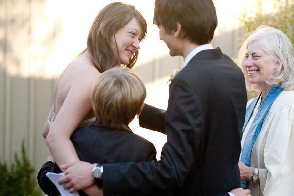 groom, bride and bride's son hugging