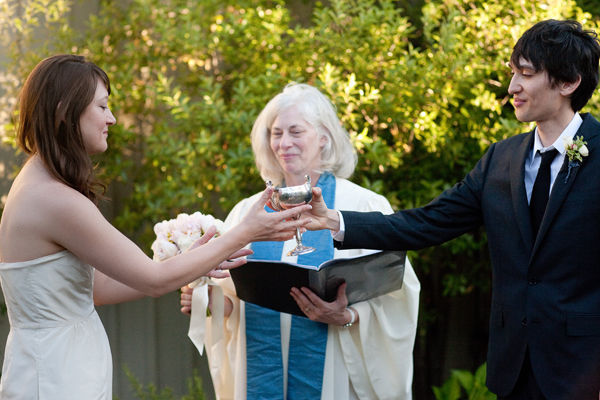 bride and groom sharing wedding chalice