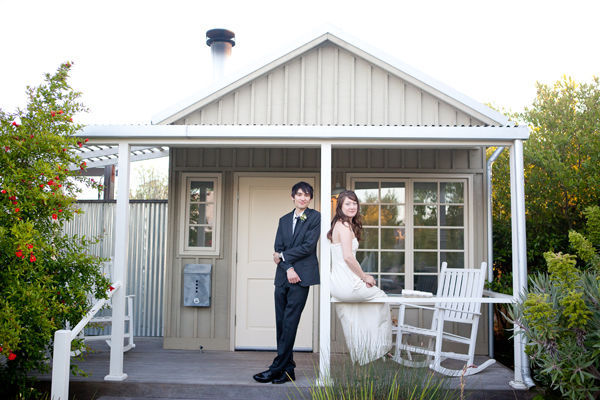 bride and groom on cottage porch