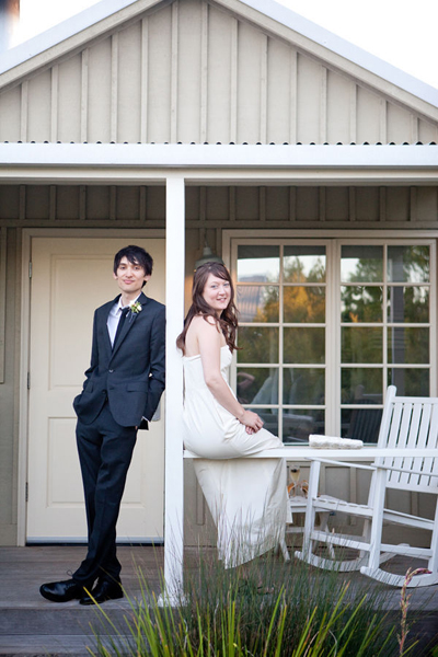 bride and groom on porch