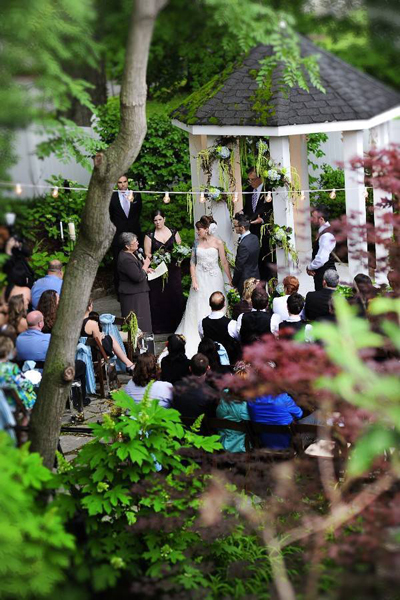 outdoor wedding ceremony in front of gazebo