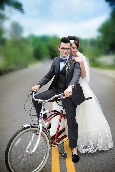 bride and groom on vintage bicycle