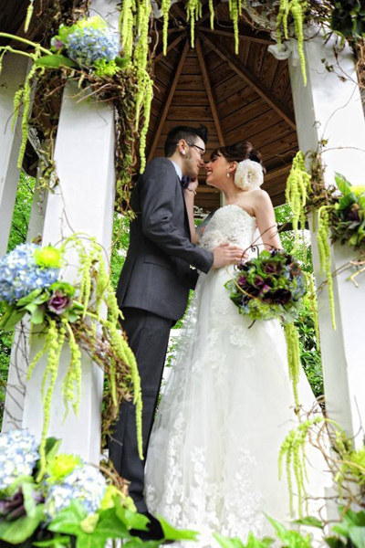 bride and groom in wedding gazebo