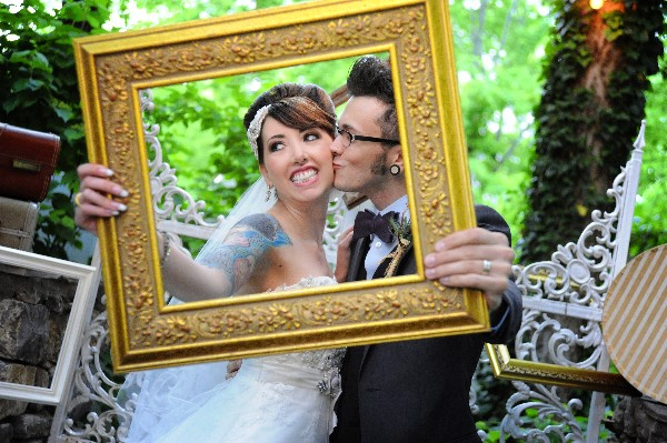 bride and groom with vintage picture frame