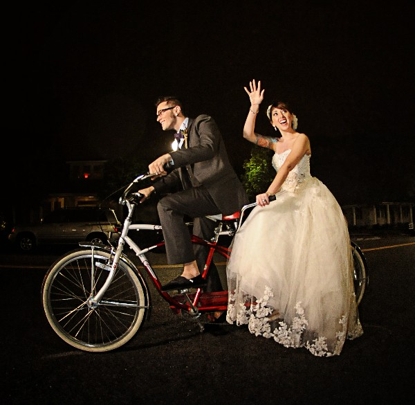 wedding getaway on tandem bicycle