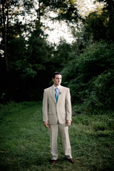 beige groom suit and blue tie