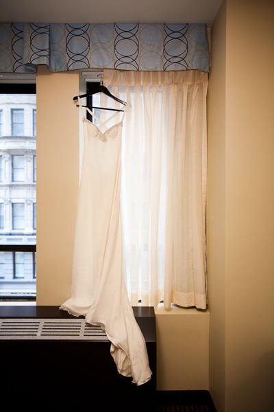 wedding dress hanging in hotel window