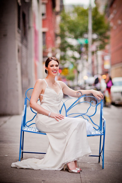 bride sitting on blue bench in New York