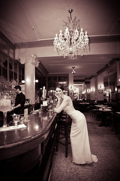 bride leaning on the bar