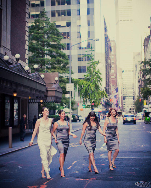 bride and bridesmaids crossing New York street