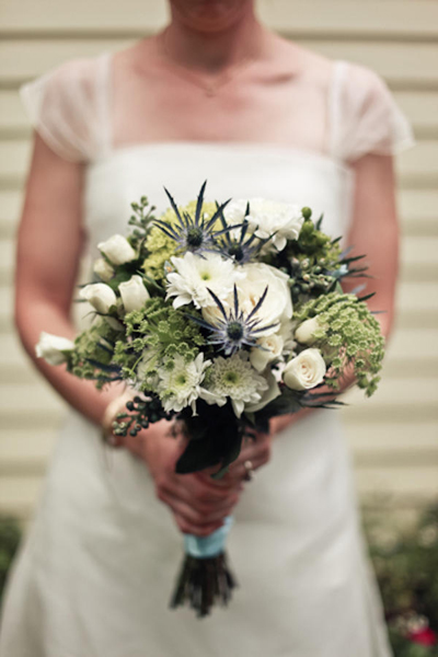 white and green wedding bouquet with thistles