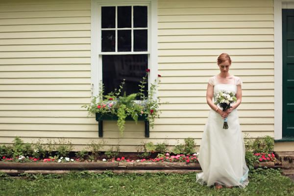 bride portrait outside yellow house