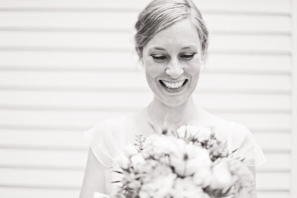 black and white portrait of smiling bride