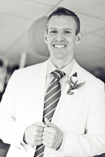 black and white portrait of smiling groom