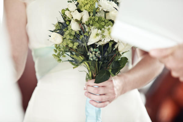 bride holding her bouquet during ceremony