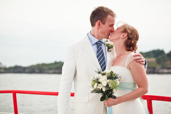 bride and groom kissing on the ferry