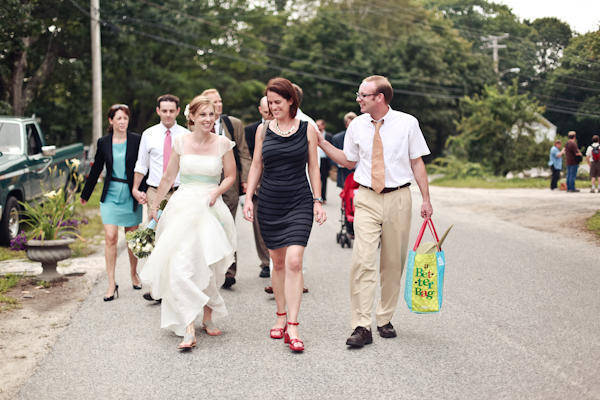 bride and guests walking to the ceremony