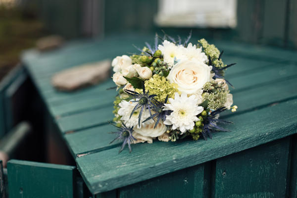 wedding bouquet on green barn board