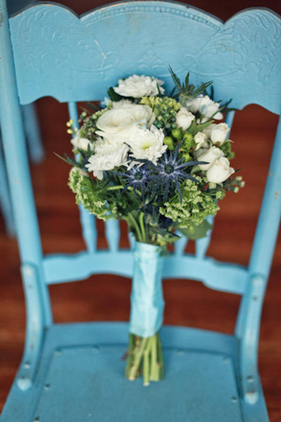 wedding bouquet on antique blue chair