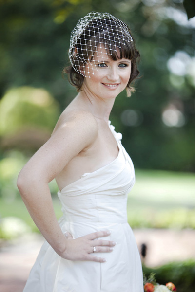 bride in simple birdcage veil
