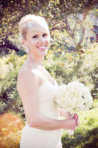 bride with all-white bouquet