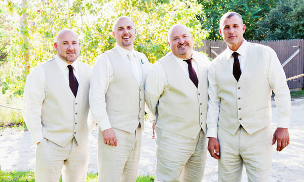 groomsmen in beige suit vests