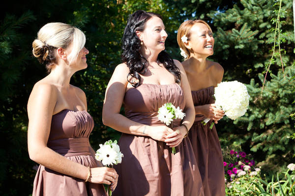 bridesmaids laughing during ceremony