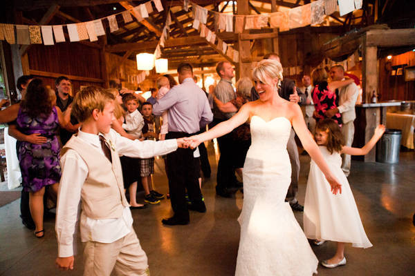 bride dancing with young guest
