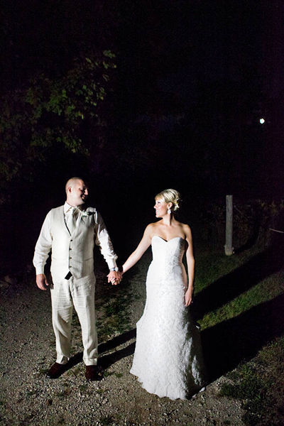 bride and groom walking at night