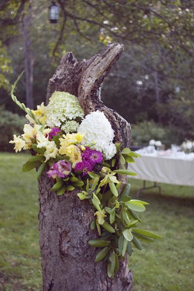 flower arrangement in tree stump