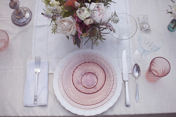 farmhouse wedding reception table setting with pink depression glass
