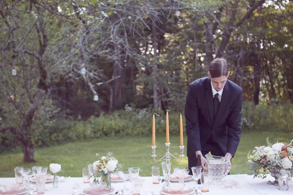 groom setting the table