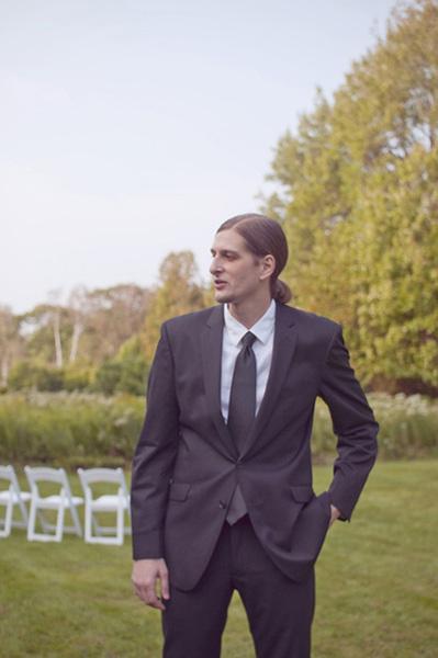 ponytailed groom