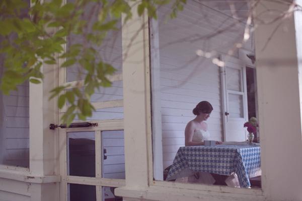 bride sitting at picnic table