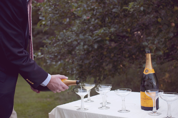 pouring champagne for wedding guests