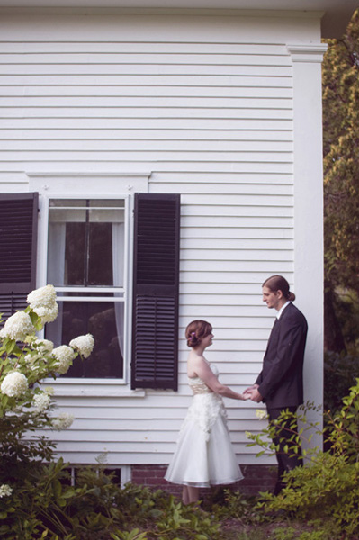 bride and groom outside victorian farmhouse