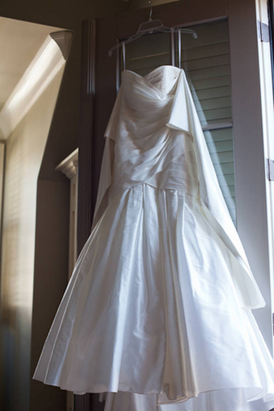 ruched wedding gown hanging up